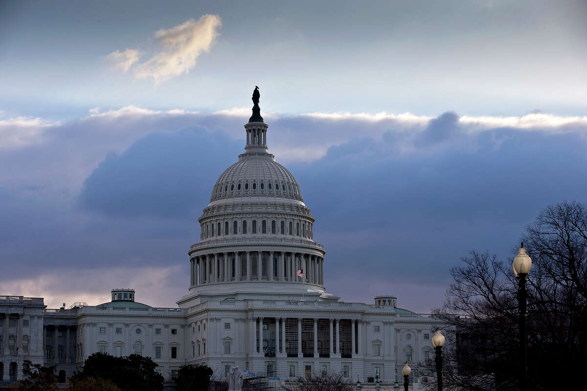 """The U.S. Capitol is seen as Congress convenes to negotiate a legislative path to avoid the so-called """"fiscal cliff"""" of automatic tax increases and deep spending cuts that could kick in Jan. 1., in Washington, Sunday, Dec. 30, 2012."""