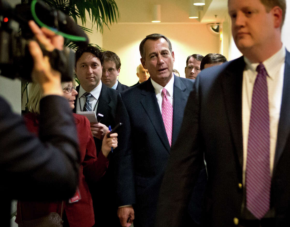 """Speaker of the House John Boehner, R-Ohio, leaves a closed-door GOP caucus meeting as Congress meets to negotiate a legislative path to avoid the so-called """"fiscal cliff"""" of automatic tax increases and deep spending cuts that could kick in Jan. 1., at the Capitol in Washington, Sunday, Dec. 30, 2012."""