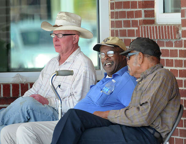 From left, John Molen, Hollis Fain, 67 and Daniel Champine, 79 sit in downtown Orange chatting about possibly fishing along the city's boardwalk that is currently under construction. Completion of the boardwalk is expected to be in March. Photo taken Friday, November 2, 2012 Guiseppe Barranco/The Enterprise Photo: Guiseppe Barranco, STAFF PHOTOGRAPHER / The Beaumont Enterprise