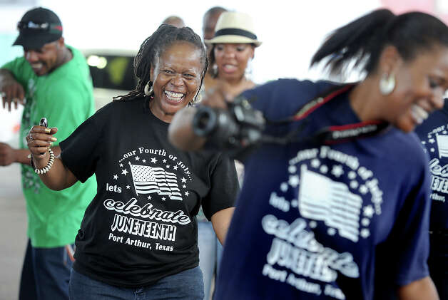Gail Pellum line dances with a group after a Juneteenth parade in downtown Port Arthur on Monday. Several local dancers, singers and speakers helped to recognizing the announcement of the abolition of slavery in the U.S. State of Texas in 1865. Photo taken Tuesday, June 19, 2012 Guiseppe Barranco/The Enterprise Photo: Guiseppe Barranco, STAFF PHOTOGRAPHER / The Beaumont Enterprise