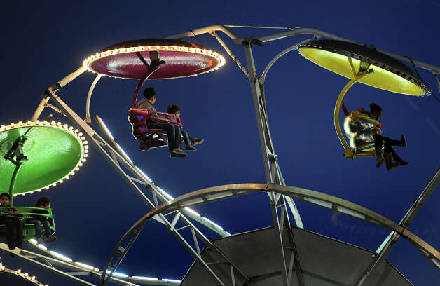 Lights from the South Texas State fair lit up Ford Park as guests rode rides and enjoyed foods Thursday night. Photo taken Thursday, March 22, 2012 Guiseppe Barranco/The Enterprise Photo: Guiseppe Barranco, STAFF PHOTOGRAPHER / The Beaumont Enterprise