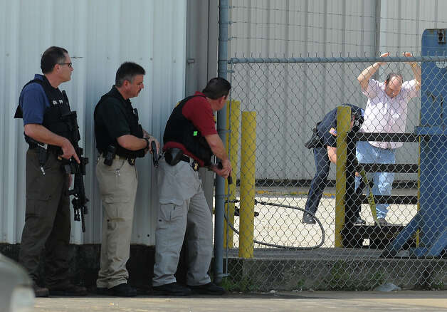 A hostage walks out of RCI after being released by alleged gunman Bartholomew Granger during a police stand off in Beaumont on Wednesday. The event stemmed from a shooting at the Jefferson County Courthouse that left several injured and one person dead. Photo taken Wednesday, March 13, 2012  Guiseppe Barranco/The Enterprise Photo: Guiseppe Barranco, STAFF PHOTOGRAPHER / The Beaumont Enterprise