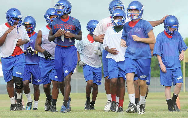 West Brook players met on the school's practice field Tuesday to drill plays and ready the team for their match up with Ozen at the BISD stadium on August 31. Photo taken Tuesday, August 14, 2012 Guiseppe Barranco/The Enterprise Photo: Guiseppe Barranco, STAFF PHOTOGRAPHER / The Beaumont Enterprise