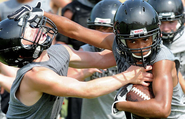 Kirbyville players met on the school's practice field Tuesday to drill plays and ready the team for their match up with Cleveland at Lamar University on August 30.  Photo taken Tuesday, July 7, 2012 Guiseppe Barranco/The Enterprise Photo: Guiseppe Barranco, STAFF PHOTOGRAPHER / The Beaumont Enterprise