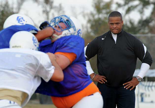 Larry Spears watches his players during practice at Community Christian School in Orange on Tuesday. The second-year program won their first playoff game last week and will play again this Saturday at 2 p.m.  Photo taken Tuesday, November 20, 2012 Guiseppe Barranco/The Enterprise Photo: Guiseppe Barranco, STAFF PHOTOGRAPHER / The Beaumont Enterprise