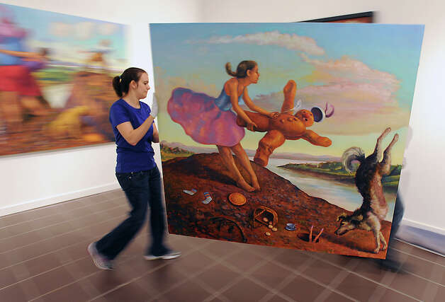 Caitlin Williams and Tim Robtoy move a work by Robert Jessup at the Art Museum of Southeast Texas. The museum's permanent collection of contemporary artists will be on display from Saturday through September 2.   Photo taken Tuesday, June 26, 2012 Guiseppe Barranco/The Enterprise Photo: Guiseppe Barranco, STAFF PHOTOGRAPHER / The Beaumont Enterprise