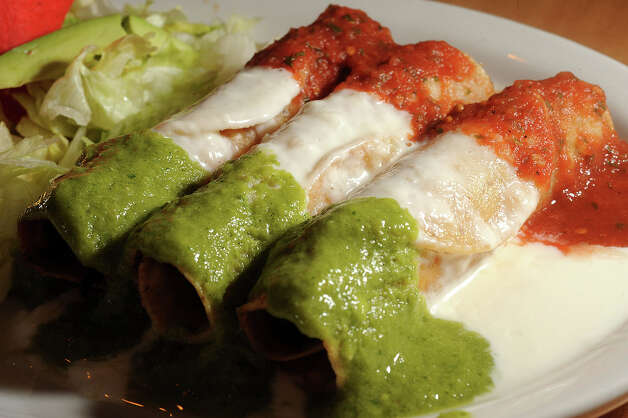 Enchiladas at Taqueria Cotija in Nederland. 3720 Avenue E Nederland, Texas. Photo taken Wednesday, October 3, 2012 Guiseppe Barranco/The Enterprise Photo: Guiseppe Barranco, STAFF PHOTOGRAPHER / The Beaumont Enterprise