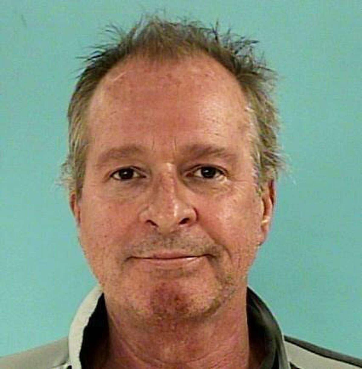 Thomas Anthony Quinlan, 58, is jailed in the shooting death of his wife Sunday night at the family home in the 140 block of North April Waters. (Montgomery County Sheriff's Office)