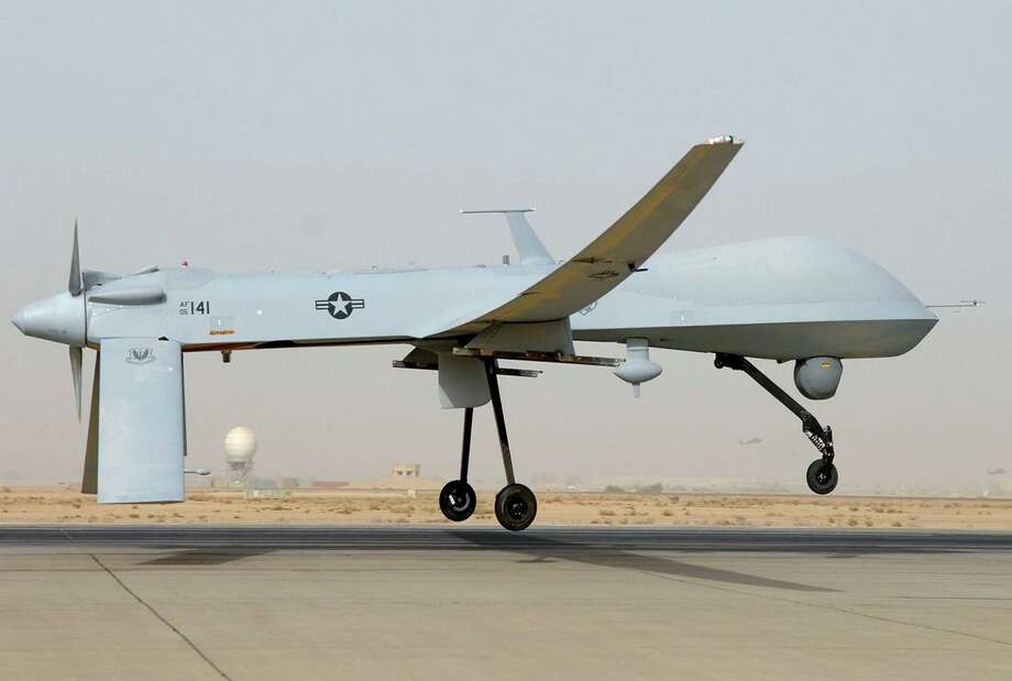 "This undated US Air Force photo shows an MQ-1 Predator unmanned aircraft as it prepares for takeoff in support of operations in Southwest Asia. Iranian fighter jets fired on an unarmed US drone in the Gulf last week and missed, the Pentagon said November 8, 2012, warning that the United States stood ready to protect its forces in the region. ""They intercepted the aircraft and fired multiple rounds,"" spokesman George Little told a news conference. The US military plane was ""never in Iranian air space"" and came under fire on November 1 from SU-25 fighters off the Iranian coast over international waters, he said. The MQ-1 Predator, a turboprop plane that flies at a much slower speed than the fighter jets, was pursued further by the Iranian warplanes but not fired on again. The Predator later returned safely to an unspecified military base in the region, Little said. The Predator was intercepted about 16 nautical miles off the Iranian coast, beyond Iran's territorial waters that extend 12 nautical miles off the country's shore, he added.  = RESTRICTED TO EDITORIAL USE - MANDATORY CREDIT "" AFP PHOTO / US AIRFORCE/JULIANNE SHOWALTER/"" - NO MARKETING NO ADVERTISING CAMPAIGNS - DISTRIBUTED AS A SERVICE TO CLIENTS = JULIANNE SHOWALTER/AFP/Getty Images Photo: JULIANNE SHOWALTER, AFP/Getty Images / AFP"