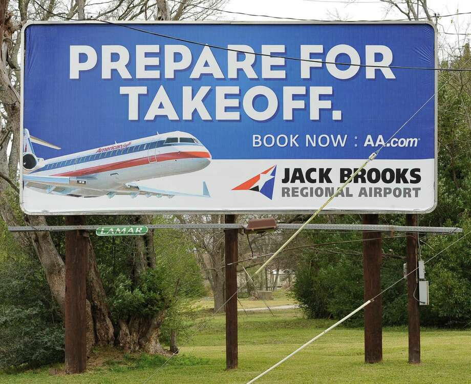This billboard on the I-10 service road before the downtown eastbound exit gives drivers notice that the new Amerian Airlines service from Jack Brooks Regional Airport is available for booking now.  Dave Ryan/The Enterprise Photo: Dave Ryan