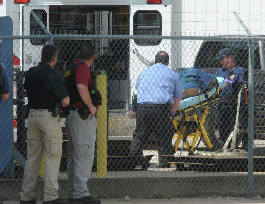 Bartholomew Granger, the accused gunman from the March Courthouse shooting, is wheeled out after a standoff with Beaumont Police at RCI in Beaumont. Photo taken Wednesday, March 13, 2012  Guiseppe Barranco/The Enterprise Photo: Guiseppe Barranco, STAFF PHOTOGRAPHER / The Beaumont Enterprise