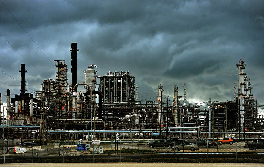 A storm rolls over Motiva in Port Arthur Thursday after the opening ceremonies for the company's Crude Expansion project. High ranking officials from Motiva, Saudi Aramco and Shell spoke at the event. Photo taken Thursday, May 31, 2012 Guiseppe Barranco/The Enterprise Photo: Guiseppe Barranco, STAFF PHOTOGRAPHER / The Beaumont Enterprise