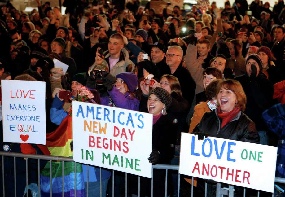 A crowd cheers at 12:30 a.m. Saturday, Dec. 29, 2012, as the first same-sex couple to be legally married in Maine departs City Hall in Portland, Maine. Photo: Robert F. Bukaty, AP / AP