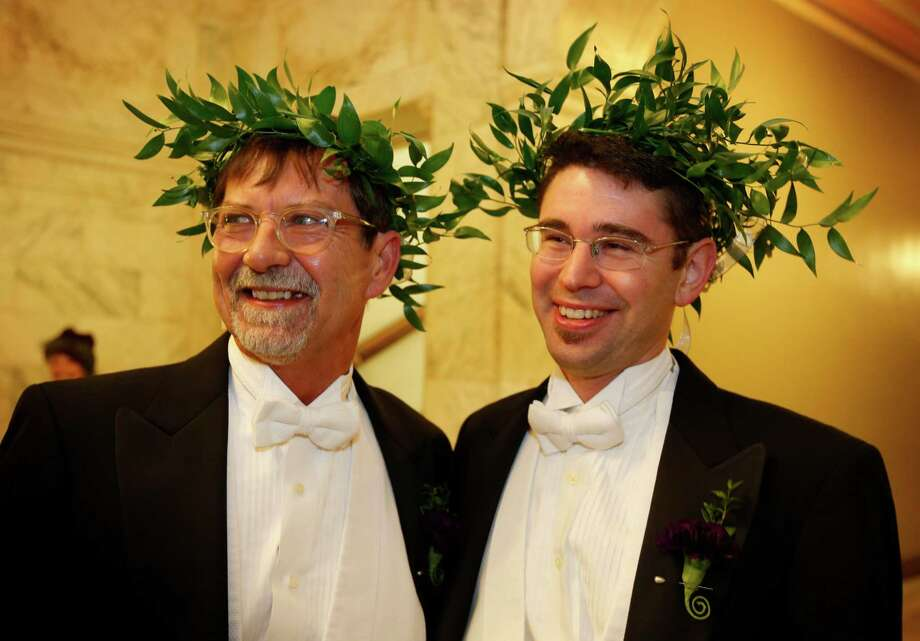 Steven Jones, left, and Jamous Lizotte wear laurel wreaths as they arrive at City Hall to obtain a marriage license, Friday, Dec. 28, 2012, in Portland, Maine. Same-sex couples in Maine will be allowed to marry as a new law goes into effect at 12:01 AM Saturday, Dec. 29, 2012. Photo: Robert F. Bukaty, AP / AP