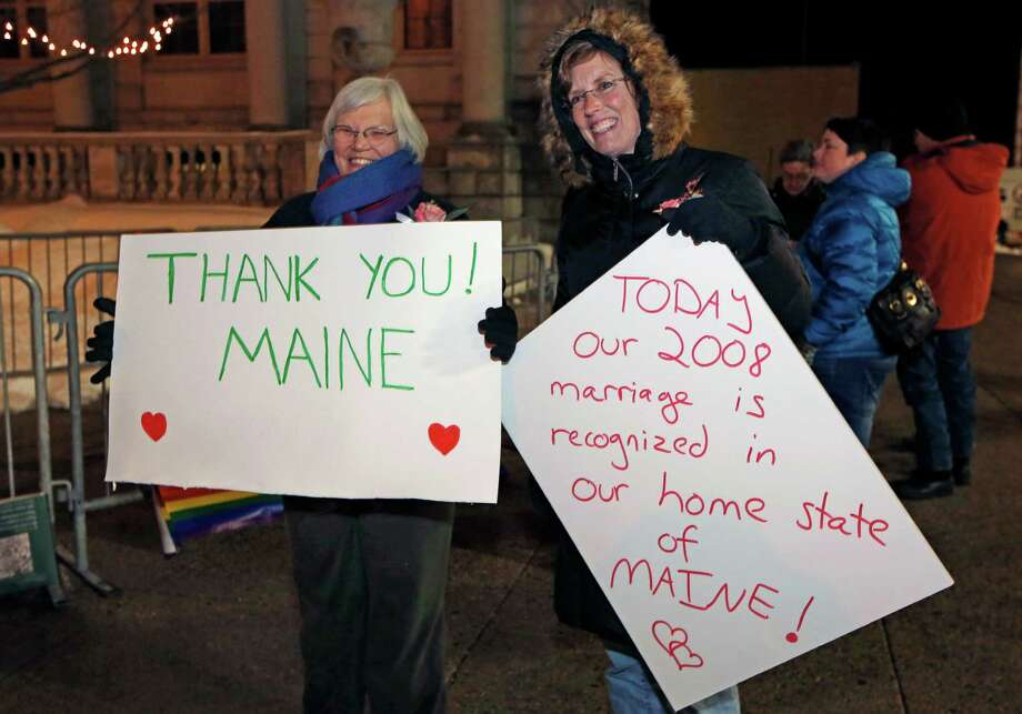 Lucie Bauer, left, and Annie Kiermaier, of Rockport, Maine, celebrate the imminent recognition of their marriage in their home state, Friday, Dec. 28, 2012, in Portland, Maine. The couple was married in California in 2008. Same-sex couples in Maine will be allowed to marry as a new law goes into effect at 12:01 a.m. Saturday, Dec. 29. Photo: Robert F. Bukaty, AP / AP