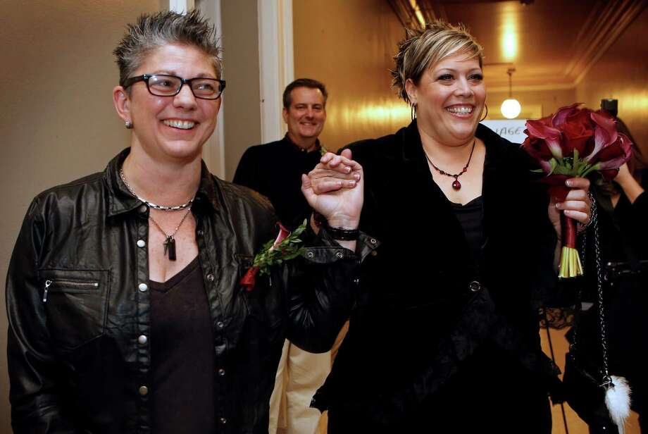 Donna Galluzzo, left, and Lisa Gorney leave the City Clerk's office after obtaining their marriage license, early Saturday, Dec. 29, 2012, at City Hall in Portland, Maine. Same-sex couples in Maine are now legally permitted to marry under a new law that went into effect at 12:01 a.m. on Saturday. Photo: Robert F. Bukaty, AP / AP