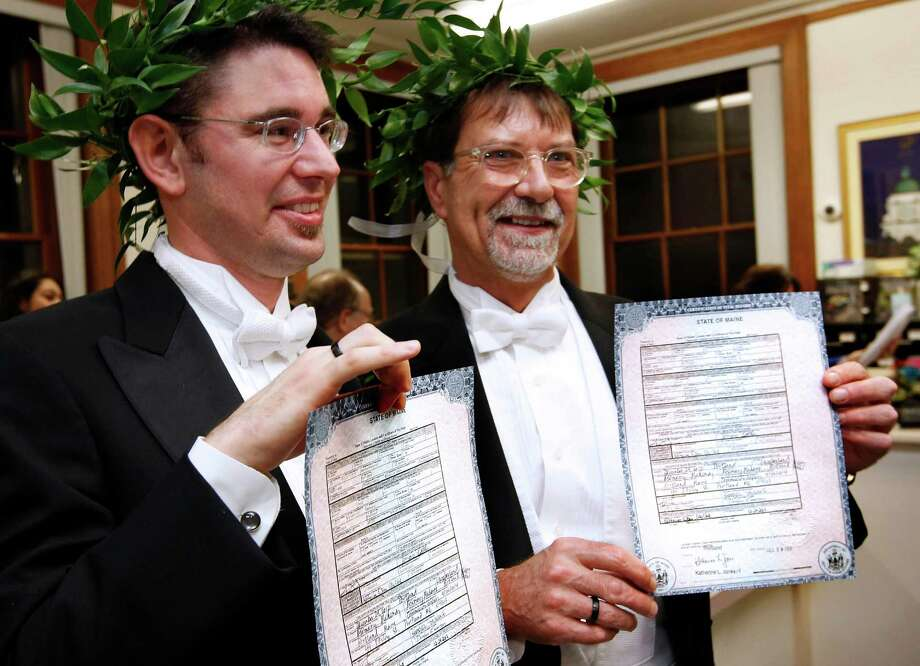 Jamous Lizotte, left, and Steven Jones pose with their marriage license, early Saturday, Dec. 29, 2012, at City Hall in Portland, Maine. Same-sex couples in Maine are now legally permitted to marry under a new law that went into effect at 12:01 a.m. on Saturday. Photo: Robert F. Bukaty, AP / AP