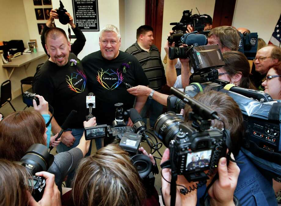 Steven Bridges, left, and Michael Snell speak to reporters after making history as the first same-sex couple to be married in the state under Maine's new law, Saturday, Dec. 29, 2012, at City Hall in Portland, Maine. Photo: Robert F. Bukaty, AP / AP
