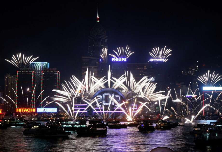 Fireworks explode at the Hong Kong Convention and Exhibition Centre over Victoria Harbor. Photo: Kin Cheung