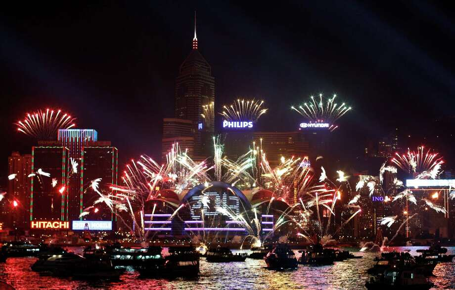 Fireworks explode in front of the Hong Kong Convention and Exhibition Centre over Victoria Harbor. Photo: Kin Cheung