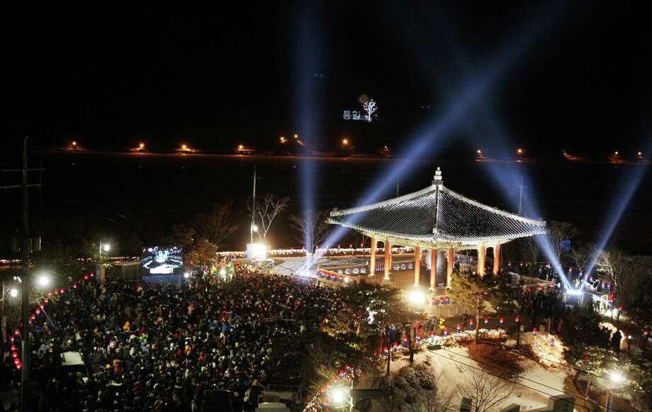 People gather to celebrate the New Year at Imjingak in Paju near the border village of Panmunjom, South Korea. About 5,000 participants prayed for a peaceful solution to the rising tension over North Korea's nuclear weapons programs and hope for an early reunification of the divided Koreas. Photo: AP