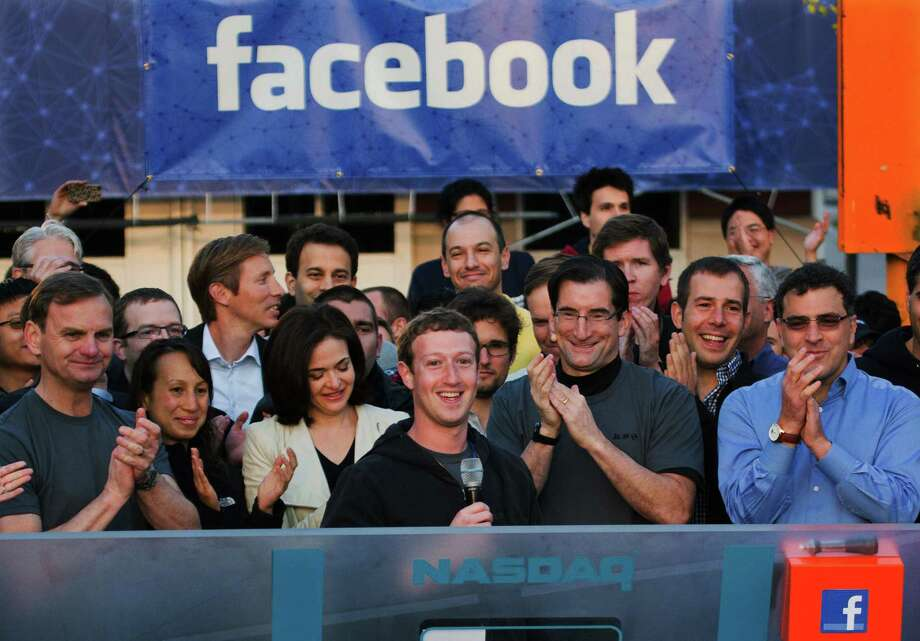 FILE -  In this May 18, 2012 file photo provided by Facebook, Facebook founder, Chairman and CEO Mark Zuckerberg, center, rings the Nasdaq opening bell from Facebook headquarters in Menlo Park, Calif. Years of anticipation led to Facebook's initial public offering of stock in 2012, the hottest Internet IPO since Google's in 2004. Many of the 1 billion-plus users of the world's largest online social network craved a chance to buy in early. On the eve of its first trading day, Facebook's market value was $105 billion, yet the IPO bombed. (AP Photo/Nasdaq via Facebook, Zef Nikolla, File) Photo: Zef Nikolla, Associated Press / Facebook