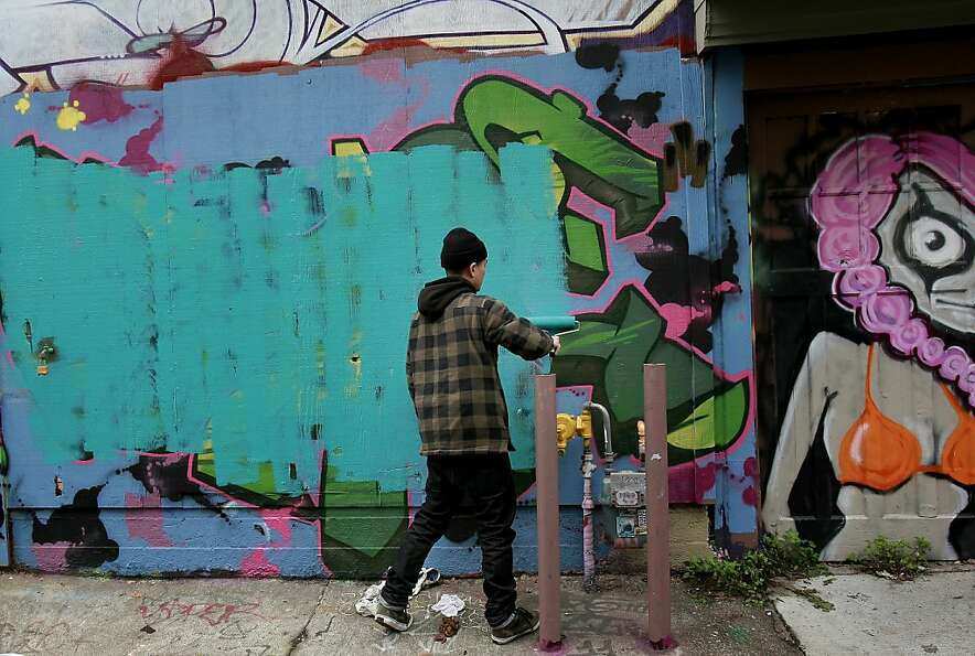 San Francisco graffiti, an impermanent art form,  is painted over by a new graffiti artist.