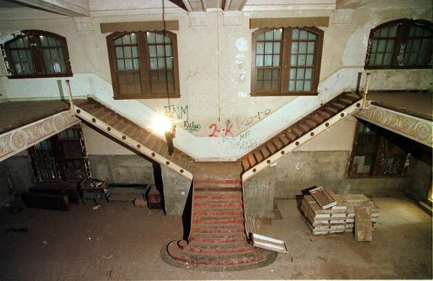 The huge staircase ascending in two directions to the second floor of the Settles Hotel in Big Spring, Texas, remains stripped of its carpet and banisters, March 17, 1999. Photo: ERIC GAY, AP / AP