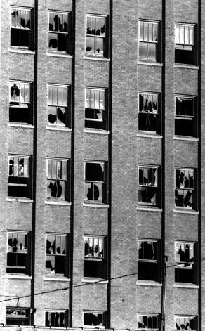 Broken windows were the rule, rather than the exception, in this 1991 photo of the Settles Hotel in Big Spring, Texas. By mid 1999, all of the windows in the once elegant hotel had been replaced, one-by-one. Photo: AP / BIG SPRING HERALD