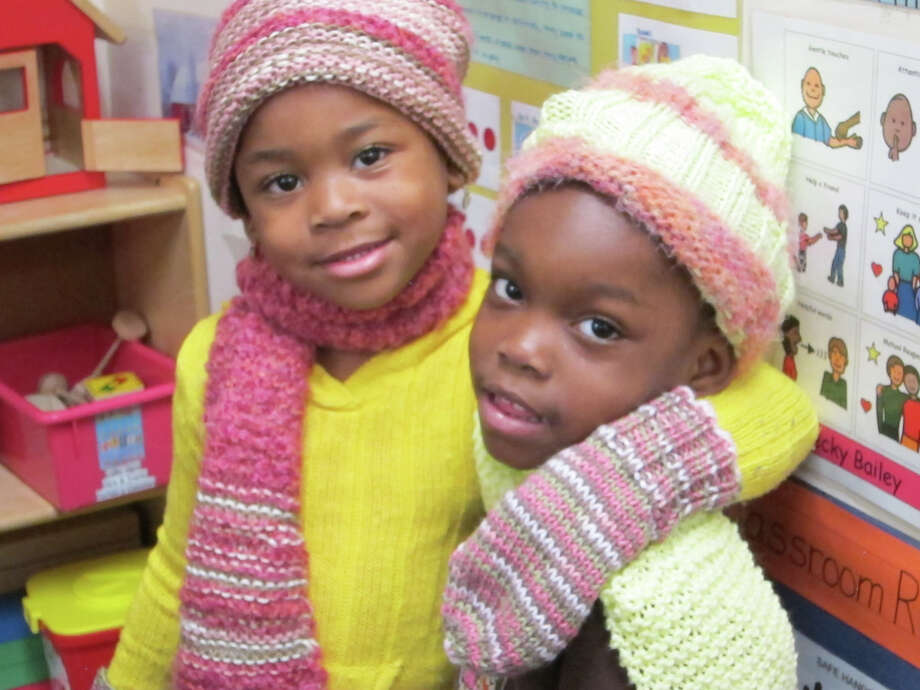 Kids in the NEON Child Development Program show off their warm weather gear that they received from RSVP recently. Photo: Contributed Photo