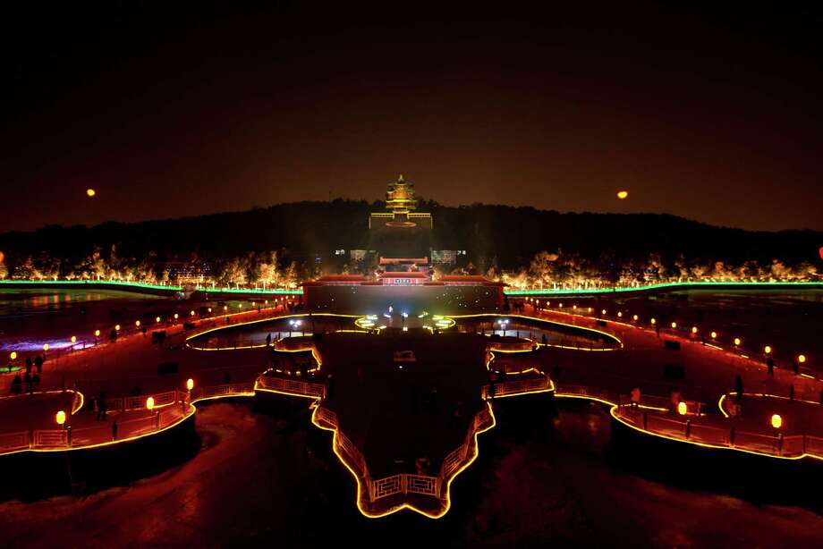 A lightshow illuminates the Summer Palace during a new year count-down event in Beijing on December 31, 2013. AFP PHOTO / Ed JonesEd Jones/AFP/Getty Images Photo: ED JONES, AFP/Getty Images / AFP