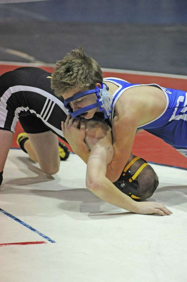 Despite losing his head gear, Cy Creek sophomore Kenny McAleavey continues to battle during a match at Cy Creek on 12-22-12. Cy Creek will be part of the 11th annual Cy-Fair ISD Invitational Tournament on Friday and Saturday, Jan. 4-5, 2013 at the Berry Center. Photo: L. Scott Hainline, Freelance / Freelance