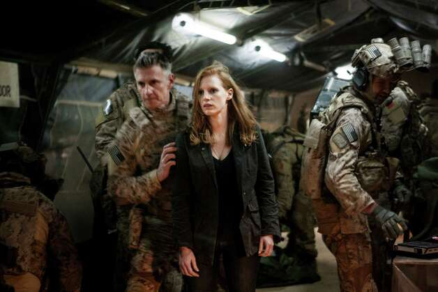 Stationed in a covert base overseas, Jessica Chastain (center) plays a member of the elite team of spies and military operatives (Christopher Stanley, LEFT and Alex Corbet Burcher, RIGHT) who secretly devoted themselves to finding Osama Bin Laden in Columbia Pictures' electrifying new thriller directed by Kathryn Bigelow, ZERO DARK THIRTY. Photo: Jonathan Olley, Columbia Pictures / ONLINE_YES