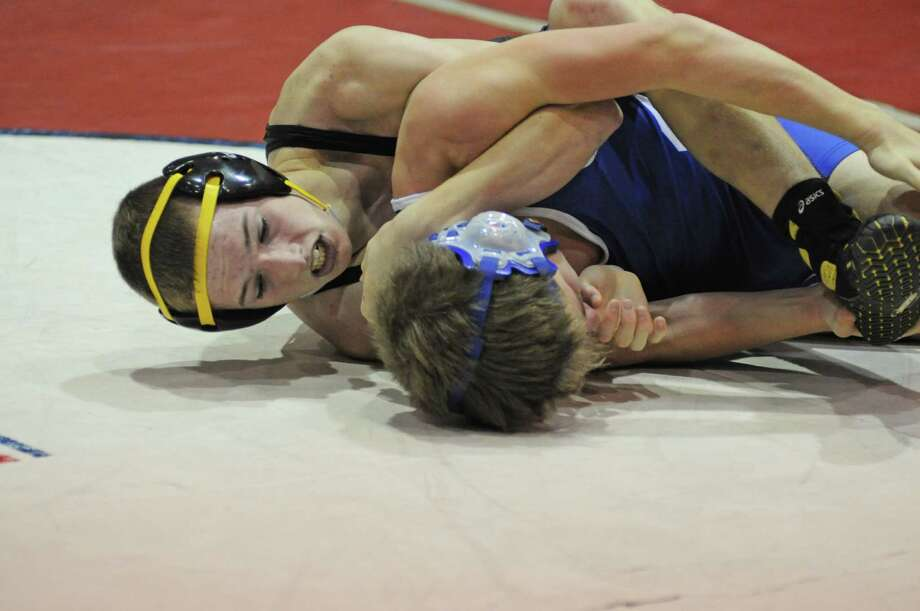 Klein Oak wrestling is rebuilding in 2012-13 with plenty of fresh faces on the mats like freshman Mitchell Howe, left, in the 120-pound division. Photo: L. Scott Hainline, Freelance / Freelance