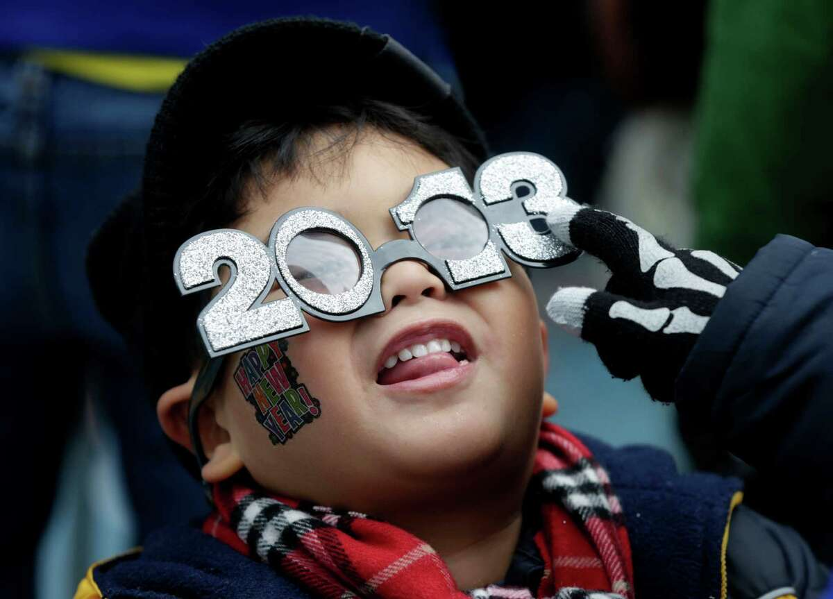 Benjamin Nadorf, 4, fools around with his new glasses while waiting for the New Year in Times Square in New York, Monday, Dec. 31, 2012. One million people are expected to cram into the area for the countdown