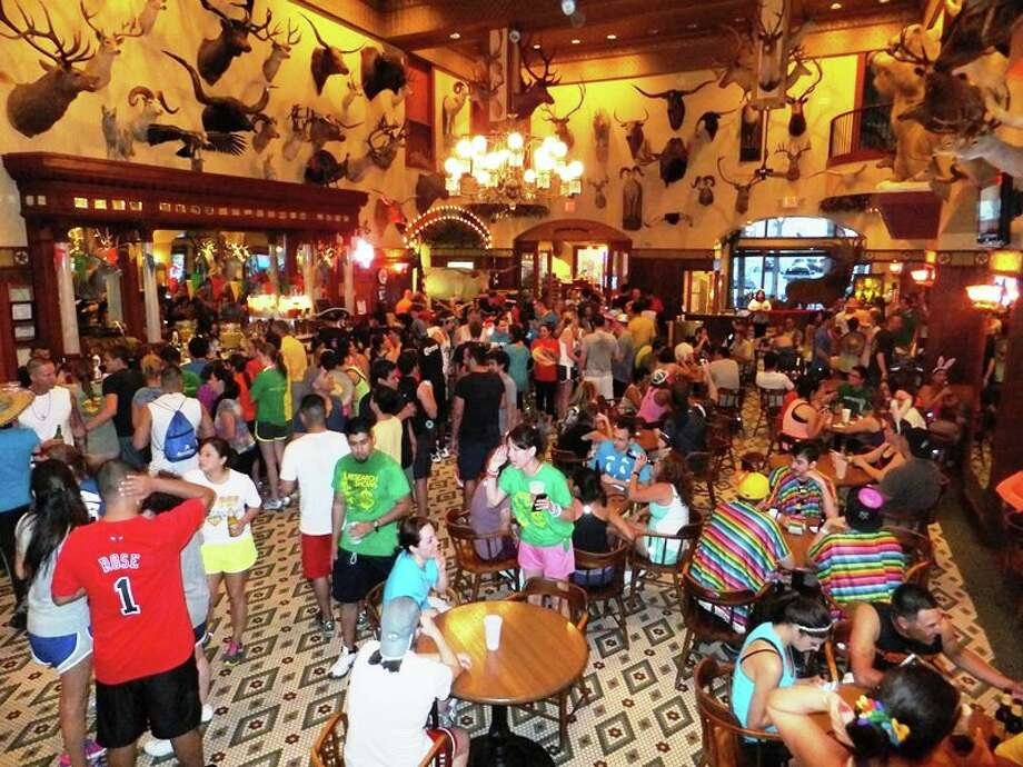 Runners gather in the Buckhorn Saloon for the 2012 edition of the Run a Tab downtown run and pub crawl Photo: Courtesy Photo