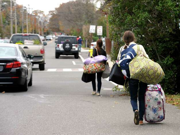 Fairfield University students leave the Lantern Point area in Fairfield, Conn. on Sunday Oct. 28, 2012. Hurricane Sandy is expected to bring heavy wind and rain and could be the worst storm to hit Connecticut in nearly 75 years. Photo: Cathy Zuraw / Connecticut Post