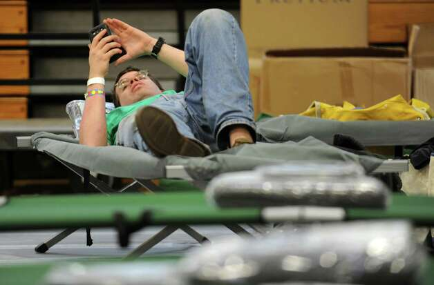 Darin Mann passes the time at the emergency shelter at Ludlowe High School in Fairfield, Conn. on Sunday Oct. 28, 2012. Mann followed orders and evacuated his Reef Road home in anticipation of flooding expected from Hurricane Sandy. Heavy wind, rain and historic flooding is possibly in Long Island Sound communities from Greenwich to East Haven. Photo: Cathy Zuraw / Connecticut Post