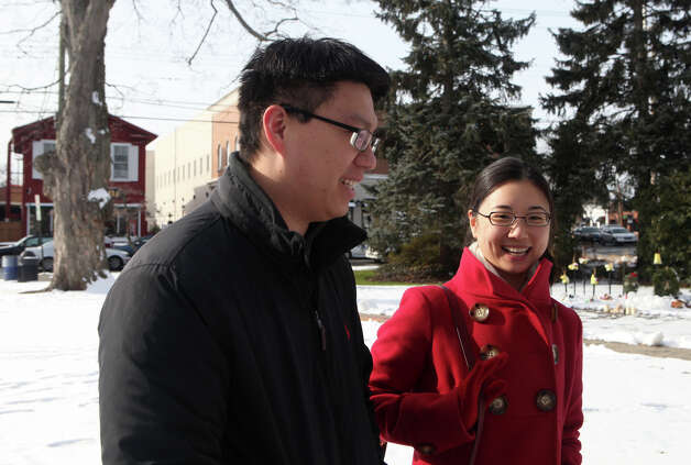 Austin and Joanne Fang, of Fairfield, contemplate the New Year in downtown Fairfield, Conn, on Monday, December 31 , 2012. Photo: BK Angeletti, B.K. Angeletti / Connecticut Post freelance B.K. Angeletti