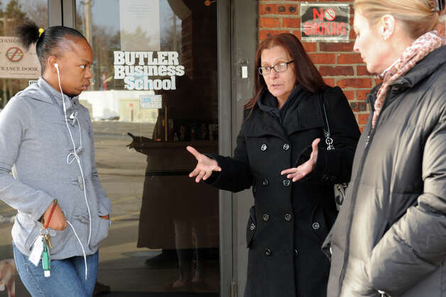 Elaine McCarthy, center, a Medical Assistant student speaks with her classmate Orlanda Austin Strong, left, and instructor Sue Waters, right, as they stand in front of Butler Business School, in Bridgeport, Conn. Dec. 31st, 2012. Students and faculty have heard over the past couple of days that the school has closed indefinately. Photo: Ned Gerard / Connecticut Post