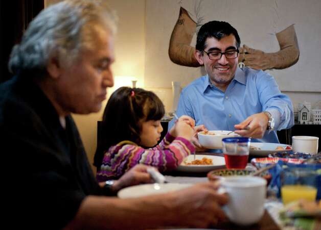 Palo Alto College President Mike Flores, right, eats with his daughter Mara and father, Ruben Flores. Photo: Darren Abate, Darren Abate/For The Express-New