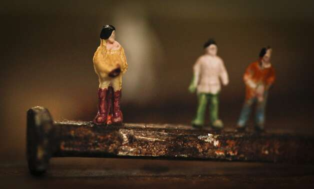 Architectural figures attached to an old nail by Clark. Photo: Russell Yip, The Chronicle