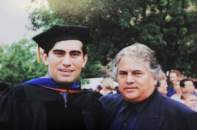 Detail of a family photograph featuring Dr. Mike Flores and his father, Ruben Flores, Sunday, Dec. 16, 2012. Photo: Darren Abate, Darren Abate/For The Express-New