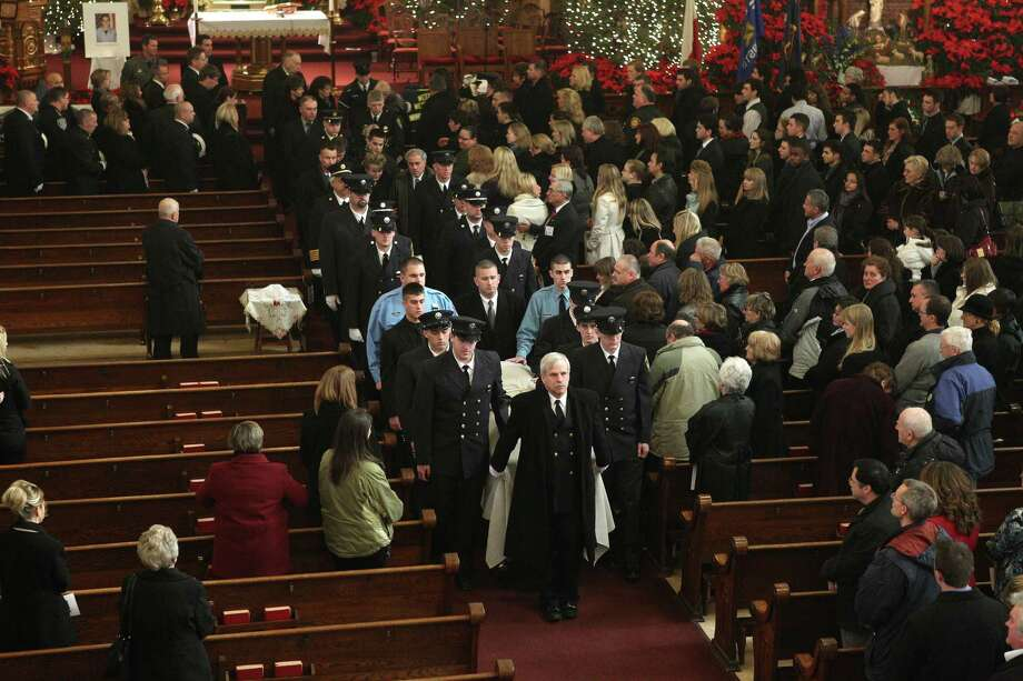 West Webster firefighters walk in procession with the casket of fellow firefighter Tomasz Kaczowka during his funeral at St. Stanislaus Church in Rochester, N.Y.,, Monday Dec. 31, 2012. Kaczowka was killed along with firefighter Michael Chiapperini  while responding to a fire  in Webster, New York on Dec. 24, 2012, where William Spengler shot at first responders. Two other firefighters were injured while seven house burned. Photo: Jamie Germano, AP / Democrat and Chronicle Pool
