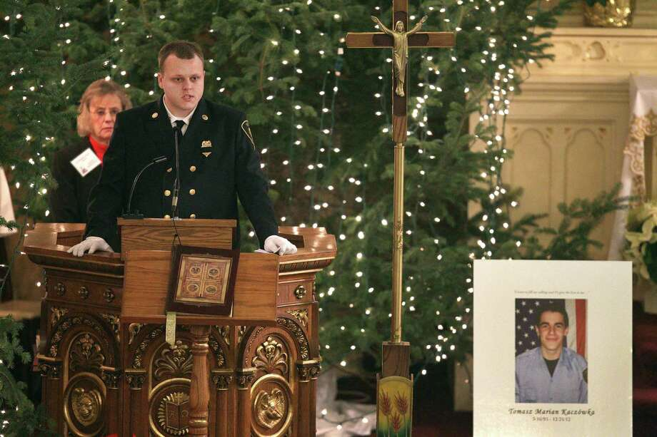 Wester webster firefighter Nick Chiapperini speaks of his friend and fellow West Webster firefighter Tomasz Kaczowka  during his funeral at St. Stanislaus Church in Rochester, New York, Monday Dec. 31, 2012.  Kaczowka was killed along with firefighter Michael Chiapperini  while responding to a fire  in Webster, New York on Dec. 24, 2012, where William Spengler shot at first responders. Two other firefighters were injured while seven house burned. Photo: Jamie Germano, AP / Democrat and Chronicle Pool
