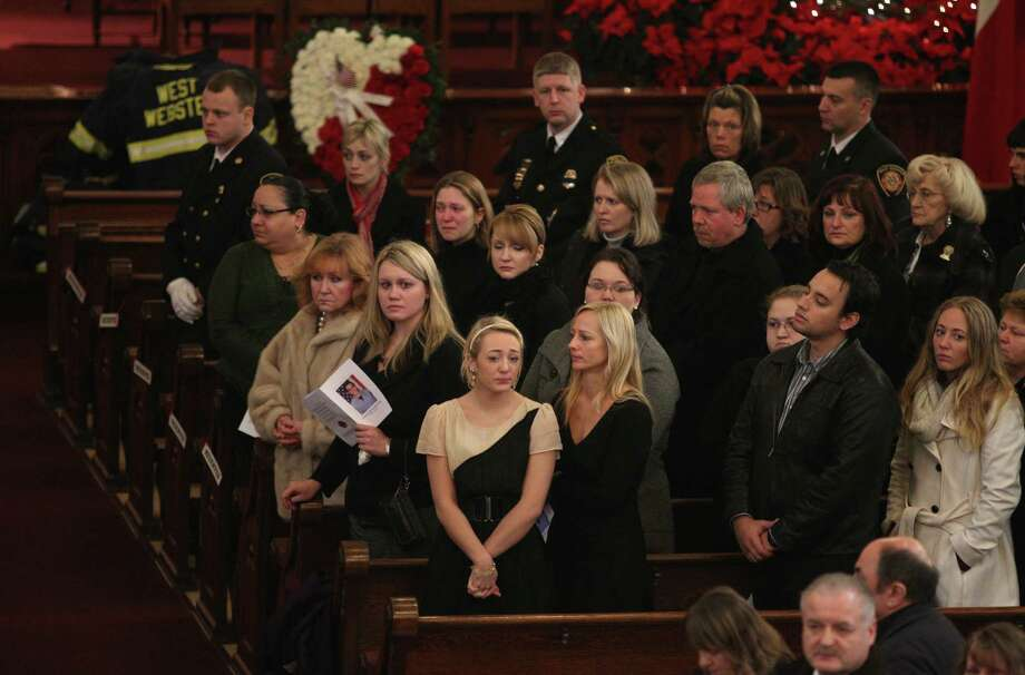 Mourners grieve during the funeral of Tomasz Kaczowka at St. Stanislaus Church in Rochester, N.Y.,, Monday Dec. 31, 2012. Kaczowka was killed along with firefighter Michael Chiapperini while responding to a fire  in Webster, New York on Dec. 24, 2012, where William Spengler shot at first responders. Two other firefighters were injured while seven house burned. Photo: Jamie Germano, AP / Democrat and Chronicle Pool