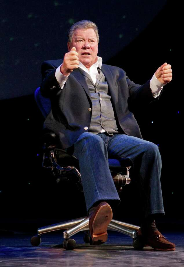 "In this theater image released by Boneau/Bryan-Brown, William Shatner performs in his one-man show, ""Shatner's World: We Just Live In It, "" at Broadway's Music Box Theatre in New York."