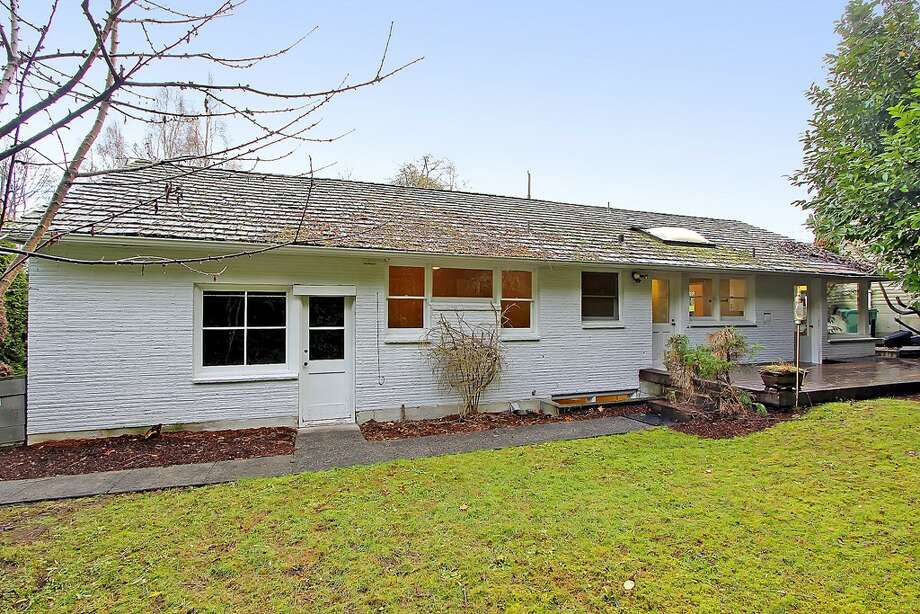 Back of 11255 Exeter Ave. N.E. The 2,180-square-foot house, built in 1949, has three bedrooms, 1.75 bathrooms, two fireplaces, a downstairs family room with a bar, and a deck on a 9,383-square-foot lot one block from the Burke-Gilman Trail. It's listed for $399,000. Photo: Courtesy Jan Snook/Windermere Real Estate