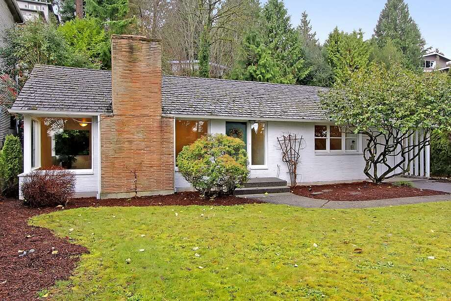 The Lake City area offers reasonable prices, by Seattle standards, for nice homes on big lots. Here are three houses listed there for $399,000 to $499,000, starting with the lowest-priced, 11255 Exeter Ave. N.E. The 2,180-square-foot house, built in 1949, has three bedrooms, 1.75 bathrooms, two fireplaces, a downstairs family room with a bar, and a deck on a 9,383-square-foot lot one block from the Burke-Gilman Trail. Photo: Courtesy Jan Snook/Windermere Real Estate