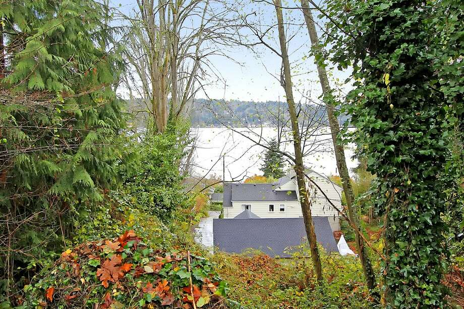 View from 11255 Exeter Ave. N.E. The 2,180-square-foot house, built in 1949, has three bedrooms, 1.75 bathrooms, two fireplaces, a downstairs family room with a bar, and a deck on a 9,383-square-foot lot one block from the Burke-Gilman Trail. It's listed for $399,000. Photo: Courtesy Jan Snook/Windermere Real Estate